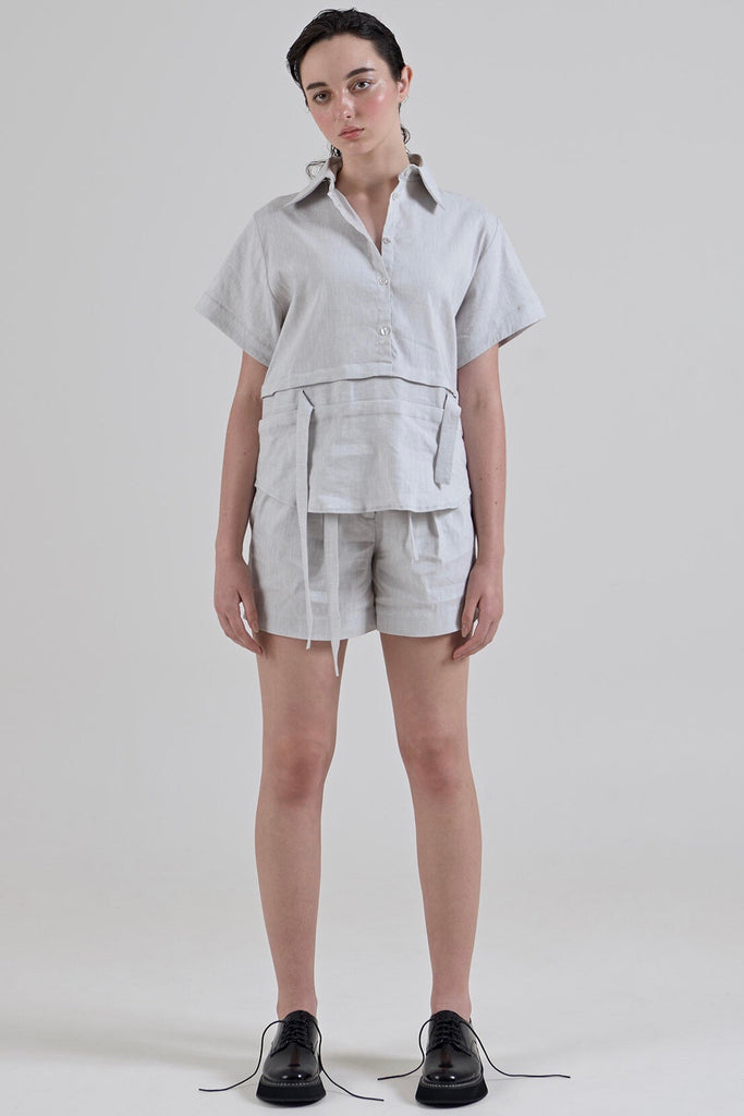 Garth Cook Double Waisted Pleat Shorts are a tailored, high waisted shorts with an integrated belt within the waistband, double front pleats, fly front, insert side seam pockets and two back pockets. Beautifully constructed with hand blind stitched hems, overlocked seams and bias binding details.  55% Linen 42% Viscose 3% Spandex  Hand wash warm water Designed and crafted in Australia