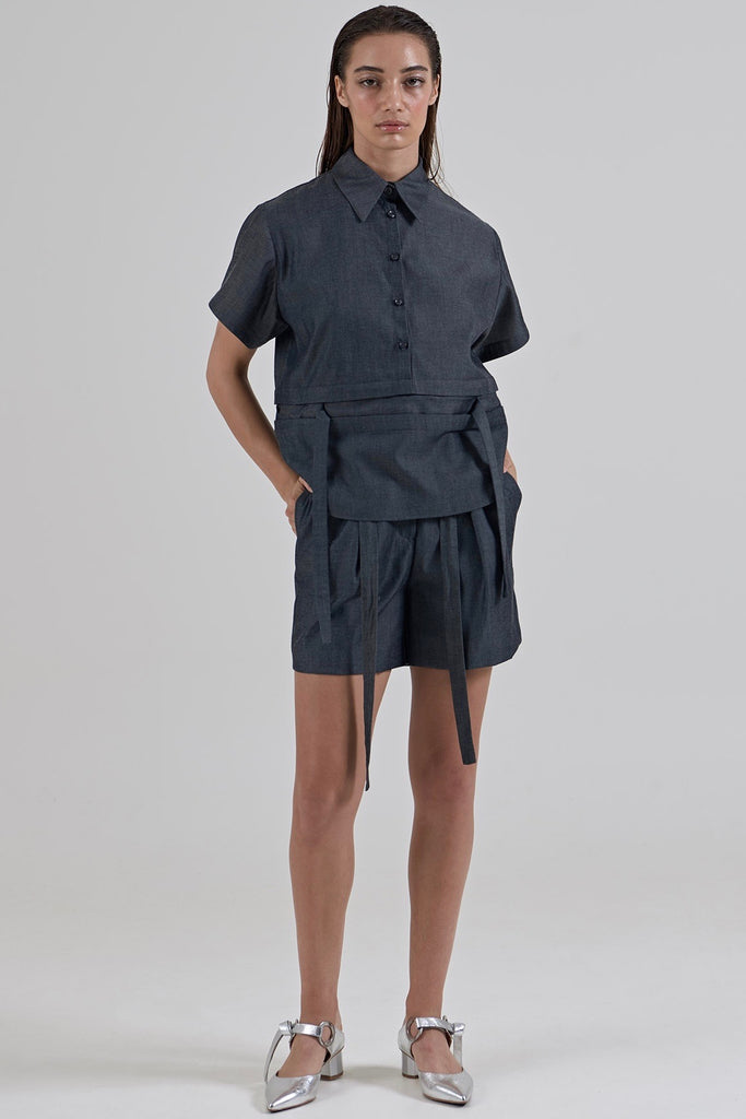 Garth Cook Submerge Waist Shirt has the ease and comfort of a shirt but the features and design of this dress set it apart. Featuring an integrated belt that can be tied multiple ways or worn without, two-piece collar and buttons to the waist. Beautifully constructed with french seams.  38% Cotton 62% Tencel Gentle machine wash Designed and crafted in Australia