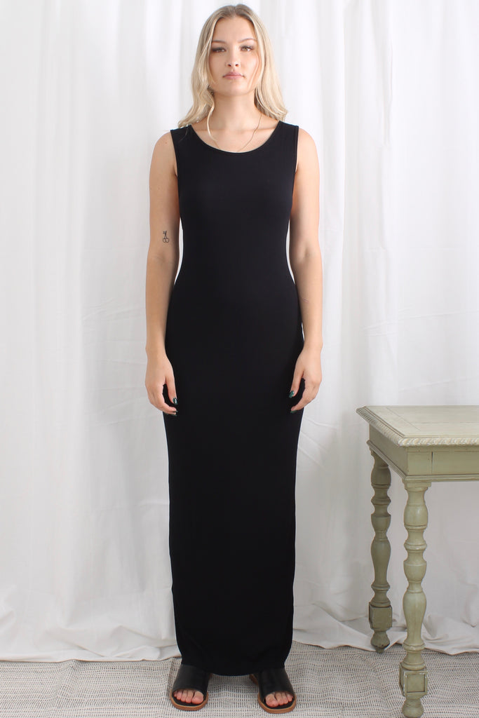 Zambesi Limbo dress is a slim fitting rib tank dress with stretch. Round neckline that cuts away to a V -back and falls straight to the ankle. Perfect on its own or under a jacket.  96% rayon 4% spandex Delicate hand wash Made in New Zealand