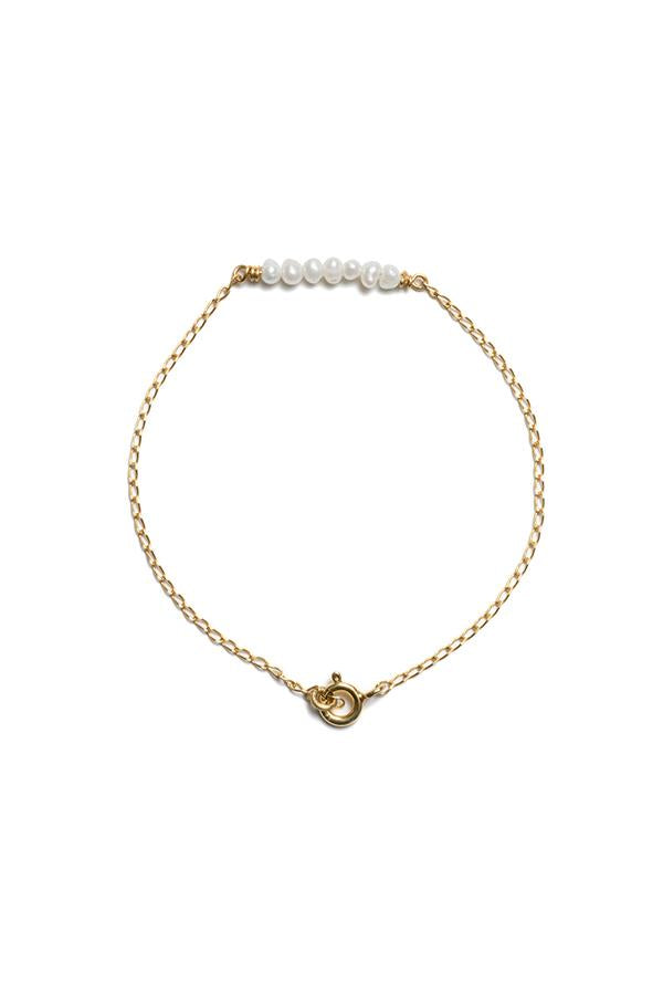 RBCCA KSTR Peppi bracelet is handcrafted in 18K yellow gold plated sterling silver chain with freshwater pearls. Length 18cm  18k yellow gold plated sterling silver Store in cool, dry place. Avoid contact with perfume and lotions.