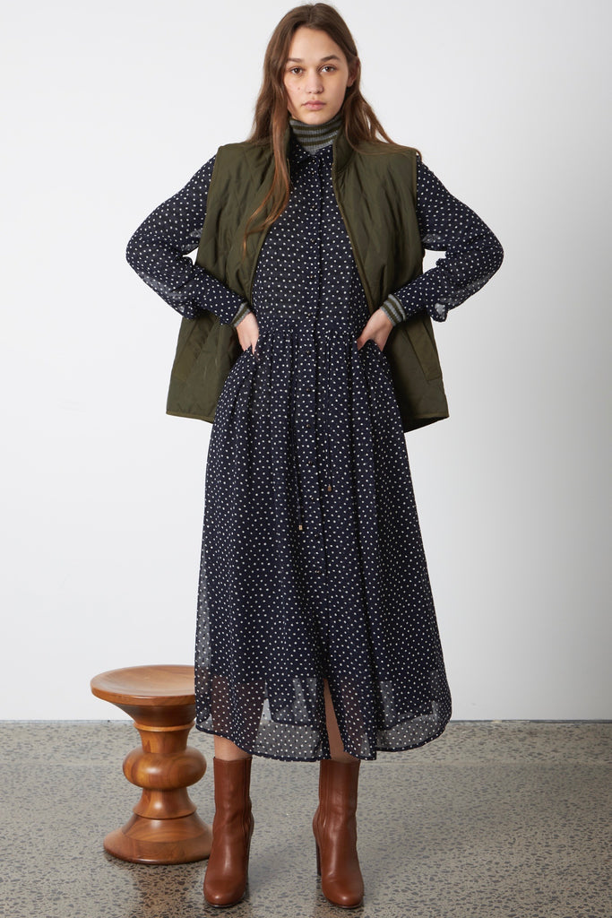 Sylvester Dotty Shirtdress has long sleeves and buttons through from collar to hem. The skirt is loosely gathered with a drawstring to pull in, and the dress comes with a slip.  100% Polyester Cool gentle hand wash