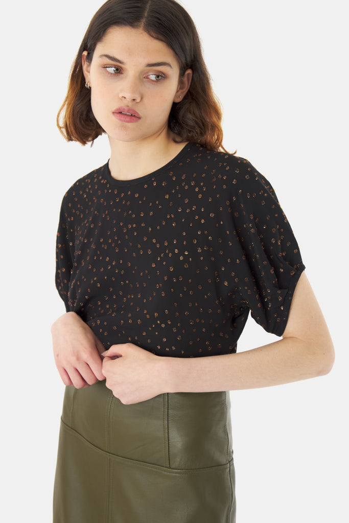 Kate Sylvester Una Top has a loose fit with a high round neckline and short sleeves that are tucked into a binding. The fabric is soft and drapey with a bronze lurex spot woven through. A perfect top for going out.  98% Viscose 2% Poly Film Lurex Cool gentle hand wash Made in New Zealand