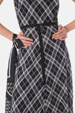 Pola Dress is a classic bias cut with a sleeveless bodice and four-panel A-line skirt. The checked fabric in black, grey and silver has a light sheen which takes the dress from day to evening, office to drinks. this style comes with a slip and narrow grosgrain belt. 100% Polyester Cool gentle hand wash