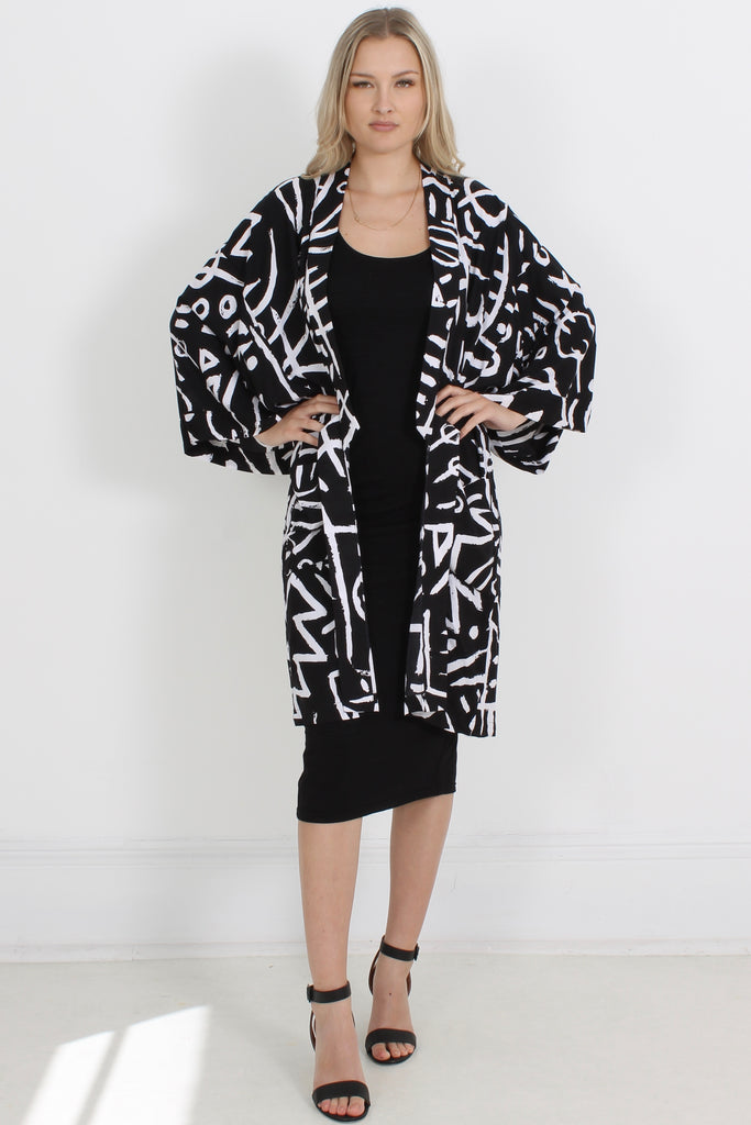 The Midi Kimono is a one size, unisex style perfect for summer. Worn as a jacket or beach cover-up, this kimono will take you from poolside to cocktails and everywhere in between. The rayon is super soft on the skin.  100% Rayon, hand printed Cool gentle hand wash in mild detergent