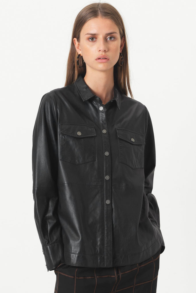 Second Female Gitte Leather Shirt is crafted in super soft lamb leather, classic shirt style with small collar, metal snap buttons, 2 front pockets and curved hemline. Classic with an edge.  100% Lamb leather Specialised dry clean only
