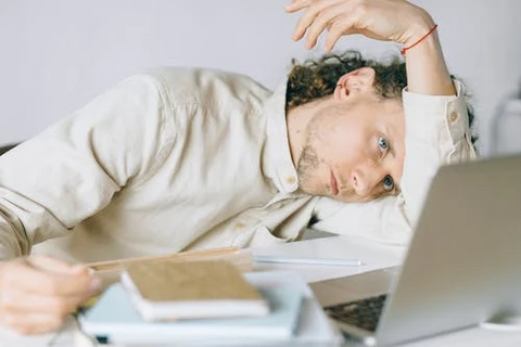 organic traditions blog post 5 ways to beat work stress and increase productivity stressed man with laptop
