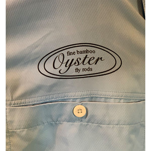 oyster bamboo fly rod logo on simms ebb tide fishing shirt