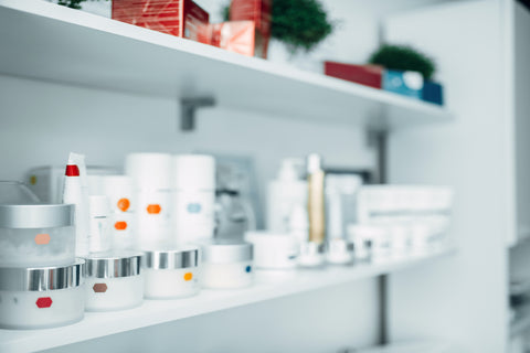 A shelf full of various skincare products
