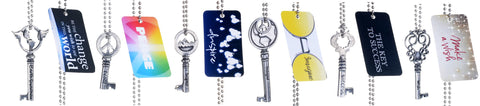 Assorted journey key charms on ball chains