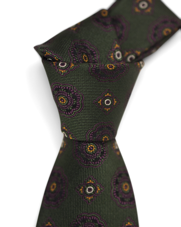 Brown medallion on green Tie
