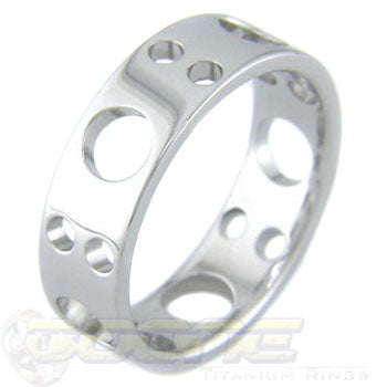 famous knife inspired bali design cut holes in a light weight  titanium ring
