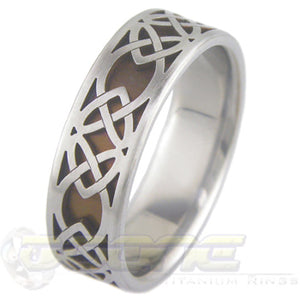 classic celtic hearts design laser cut on outer titanium ring and laser welded to inner ring which can be anodized to color of your choosing