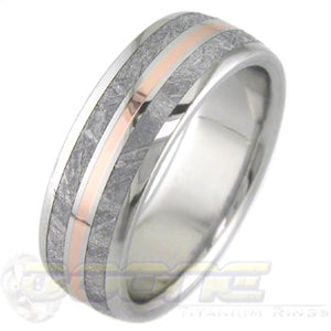 flat profile titanium ring with twin meteorite inlays on outer edges and rose gold center inlay