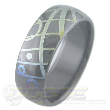 geometric design laser engraved on black zirconium ring with varied color fades known as chroma