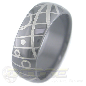 geometric design laser engraved on black zirconium ring with white on black motif known as tuxedo
