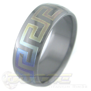 greek key design laser engraved on black zirconium ring with varied color fades known as chroma