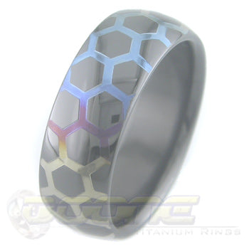 honey comb design laser engraved on black zirconium ring with varied color fades known as chroma
