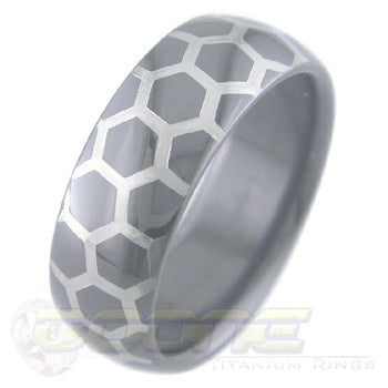honey comb design laser engraved on black zirconium ring with white on black motif known as tuxedo