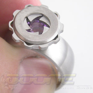 iris ring with working mechanisim which can hide  a stone or a laser engraved initial