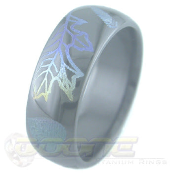 leaves design laser engraved on black zirconium ring with varied color fades known as chroma