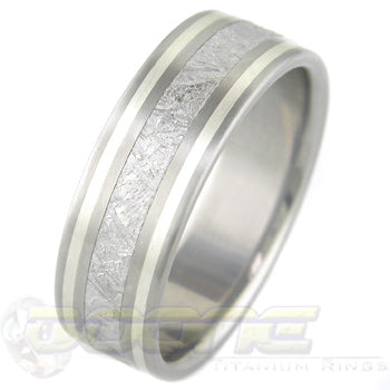 flat profile titanium ring with center inlay of meteorite and twin sterling silver inlays on each side of meteorite