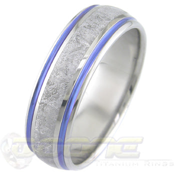 titanium ring with center inlay of meteorite and anodized color (blue is pictured) on each side of meteorite