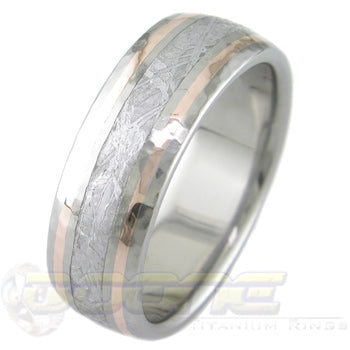 titanium ring with center inlay of meteorite and twin 14 karat rose gold inlays on each side of meteorite
