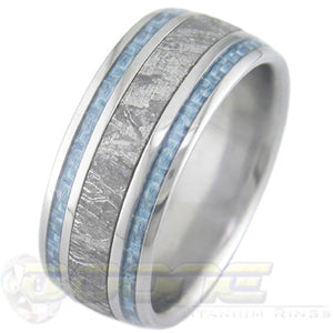 titanium ring with wide center meteorite inlay and twin light blue carbon fiber inlays on each side of meteorite
