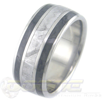 titanium ring with wide center meteorite inlay and twin black carbon fiber inlays on each side of meteorite