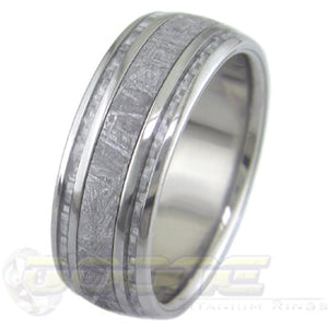 titanium ring with wide center inlay of meteorite and twin silver carbon fiber inlays on each side of meteorite