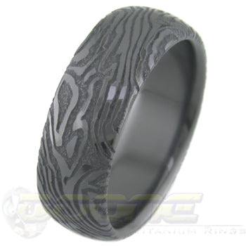 mokume gane design laser engraved (mokulaze) into black zirconium ring