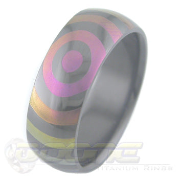 orbit design laser engraved on black zirconium ring with varied color fades known as chroma