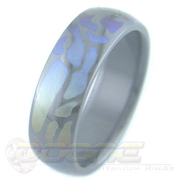 path design laser engraved on black zirconium ring with varied color fades known as chroma