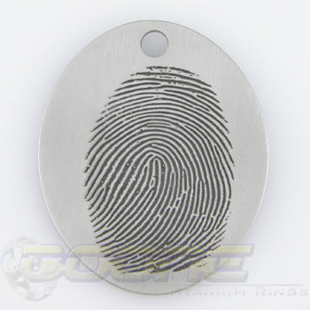 custom fingerprint laser engraved onto titanium pendant