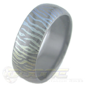 siberian tiger claw mark design laser engraved on black zirconium ring with varied color fades known as chroma