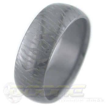 siberian tiger claw mark design laser engraved on black zirconium ring with black on black motif known as stealth