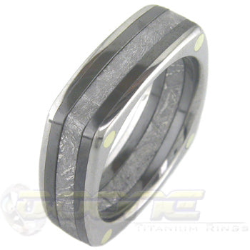 square shaped ring made from plates of titanium, black zirconium and a thick slab of meteorite