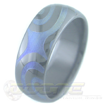 torque design laser engraved on black zirconium ring with varied color fades known as chroma