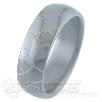 tread marks design laser engraved on black zirconium ring with varied color fades  known as chroma