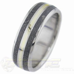 titanium ring with center inlay of gold and twin blackened meteorite inlay on each side of gold inlay