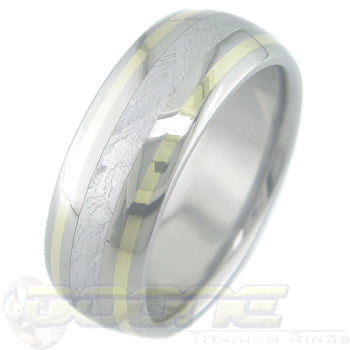 titanium ring with center inlay of meteorite and gold inlay on each side of meteorite