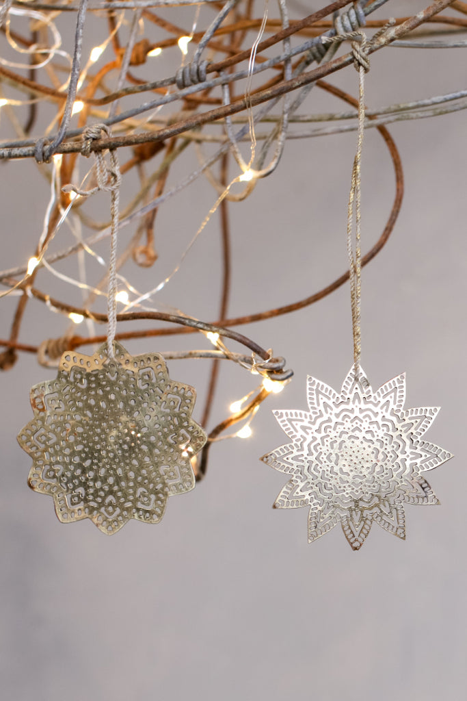 Brass snowflake decorations: set of four