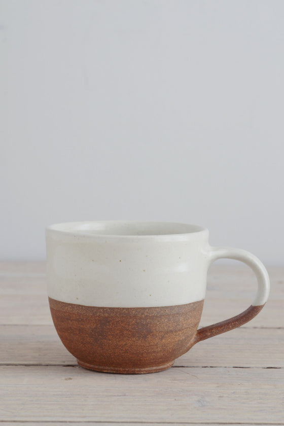 Dipped terracotta cup