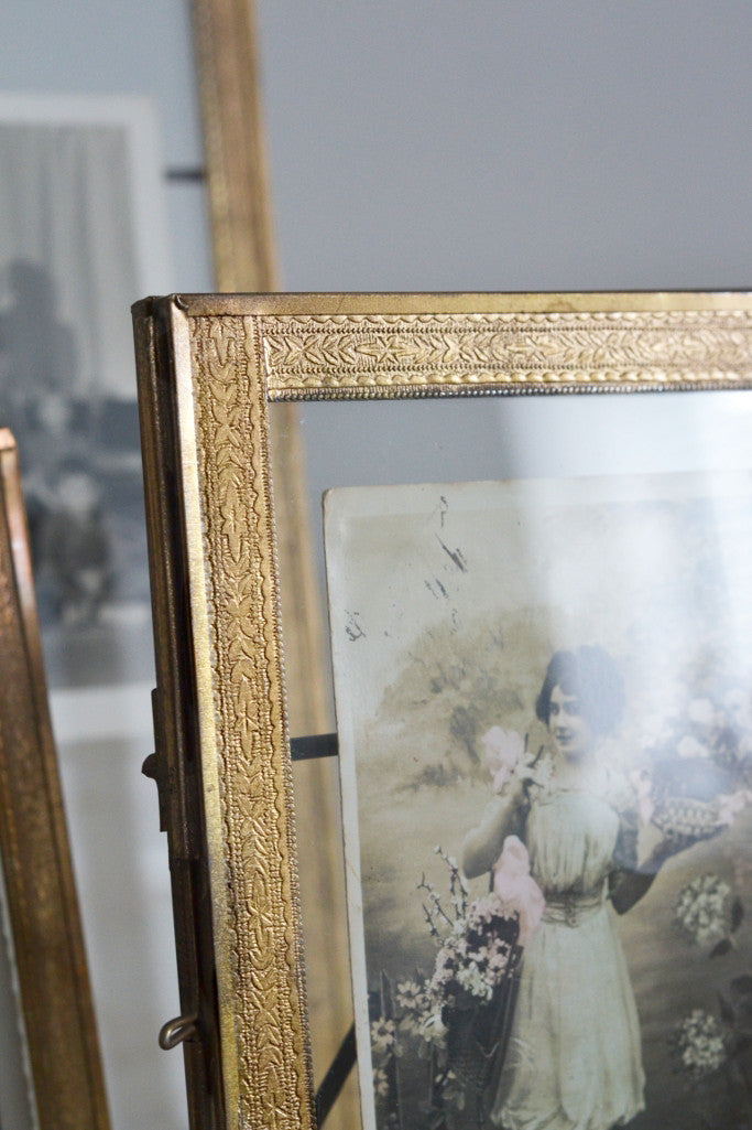 Double sided picture frame: standing brass