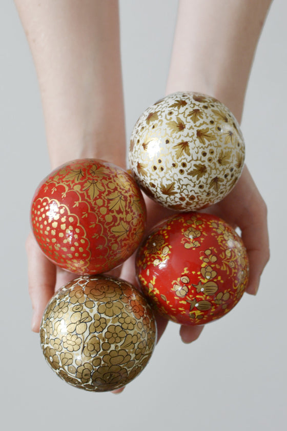 Four hand-painted baubles: Red and Gold