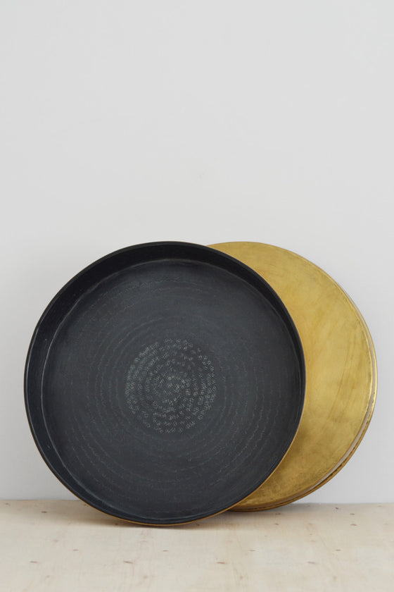 Embossed brass and black tray