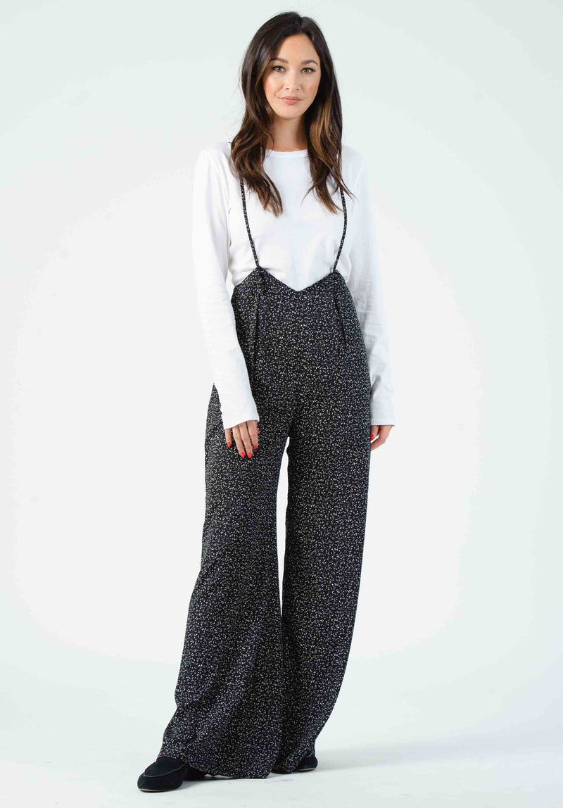 MAUI CROSS RUFFLE JUMPSUIT | BLACK