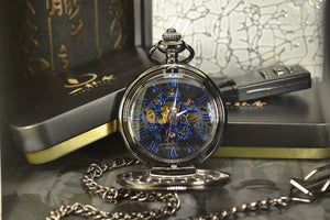 open modern pocket watch with blue hands