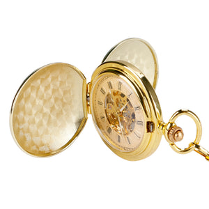 gold pocket watch at an upside down angle