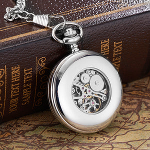 modern silver pocket watch with a transparent back